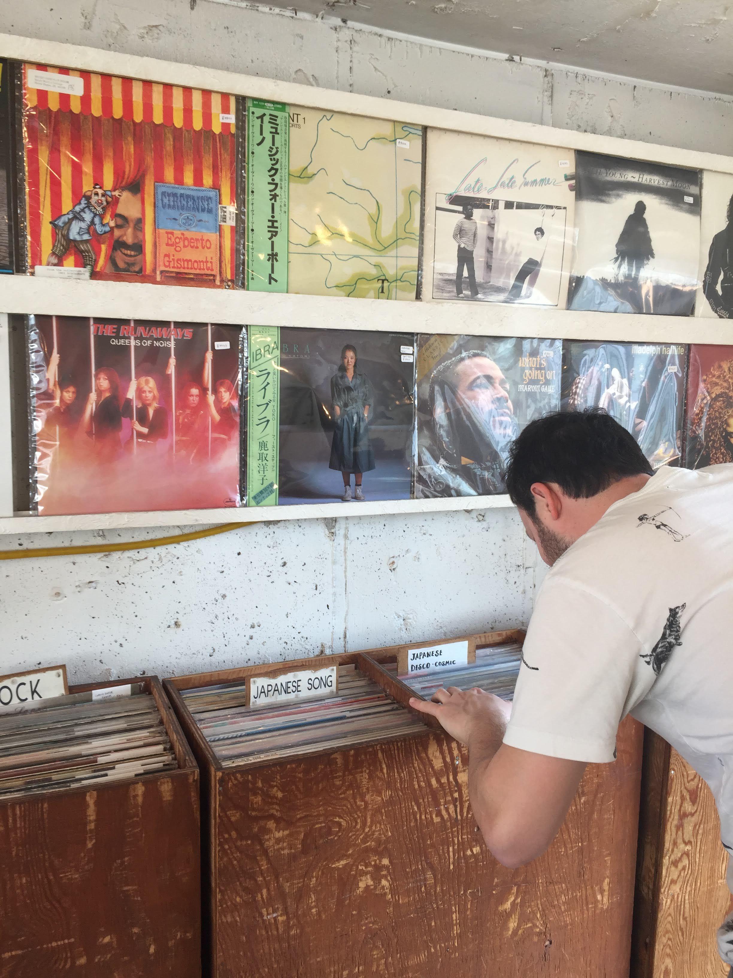 Digging for records at City Country City Record Shop in Shimokitazawa Tokyo Japan